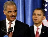 Eric Holder (left), Barack Obama
