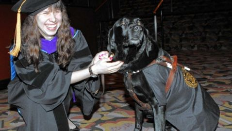 Seeing-Eye Dog Aides Law Student