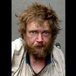 Officer Offs Pen-Wielding Double Amputee