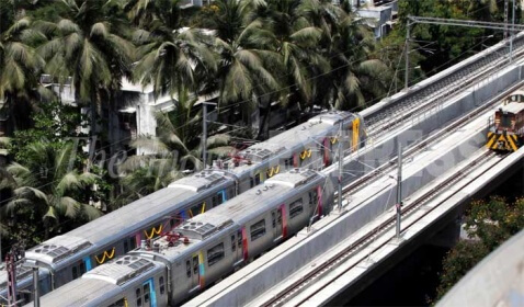 Mumbai's Metro Train Moves Along