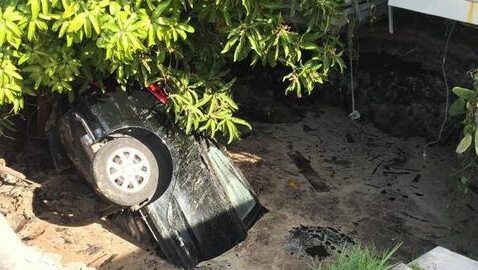 sinkhole, Florida, car swallowed by sinkhole