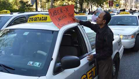 Forty-five cab companies have filed suit against Uber in federal court.