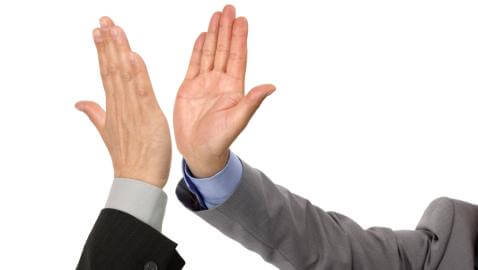 Giving a high five is not a good way to win over someone during a job interview.