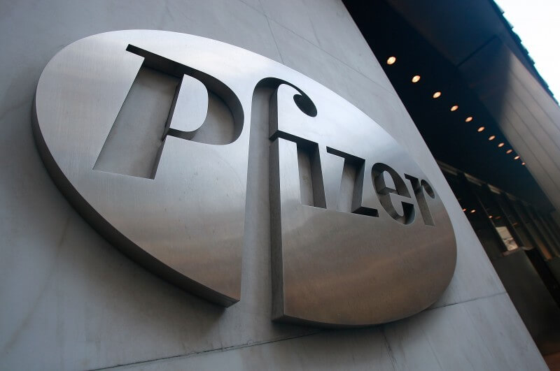 NEW YORK - JANUARY 26:  A Pfizer sign hangs on the outside of their headquarters after a news conference discussing the planned merger of Pfizer and Wyeth January 26, 2009 in New York City. Pfizer plans to acquire Wyeth for $68 billion creating the world's largest biopharmaceutical company.  (Photo by Mario Tama/Getty Images)
