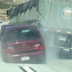 "Breaking Footage: Semi ""Unknowingly"" Drags Sedan Up Cajon Pass"