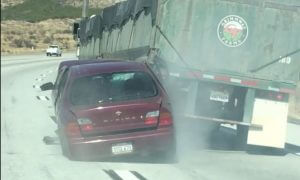 truck dragging car